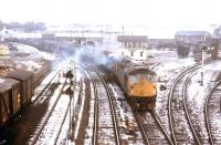 On a winter's day in early 1973 a northbound double-headed special accelerates out of the Rose Street curve in Inverness. The Harbour Branch is on the left and Platforms 5 and 6 of Inverness Station lie off to the right.<br><br>[David Spaven&nbsp;//1973]