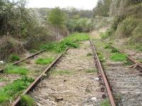 Track still in situ on the former branch to Milford Haven dockside in April 2012. View back towards the operational line connection, with Victoria Road overbridge behind the camera. The station is some 50 metres off to the left - with a car park light visible in the background.<br><br>[David Pesterfield&nbsp;18/04/2012]