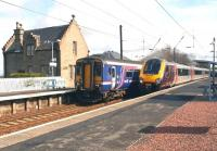Long and short distance train services pass at Kirknewton on 17 April 2012.<br><br>[John Furnevel&nbsp;17/04/2012]