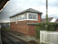 The large Pembrey signal box sited on the north side of the West Wales main line to the east of Pembrey & Burry Port station. Photographed from a passing west bound train on 18 April 2012. <br><br>[David Pesterfield&nbsp;18/04/2012]