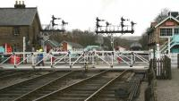 The gates of Front Street level crossing at Grosmont looking north towards the station on 3 April 2008. Standing at the platforms on this occasion are A4 Pacific no 60009 <I>Union of South Africa</I> awaiting its departure time with a train for Pickering, with EE Type 3 no D6700 stabled just beyond the signal box.<br><br>[John Furnevel&nbsp;03/04/2008]