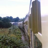A 2+2 push-pull working with an 0-6-0PT sandwiched in between approaching Staverton on the Dart Valley Railway on 30 July 1969.<br><br>[John McIntyre&nbsp;30/07/1969]