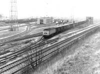 A Brush Type 4 locomotive takes an up freight out of a pre-electrification Kingmoor Yard in April 1971. Note the surviving water tank in the right middle distance.<br><br>[John Furnevel&nbsp;02/04/1971]