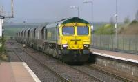 Killoch - Drax loaded coal hoppers passing New Cumnock on 26 April with Freightliner 66585 in charge.<br><br>[Ken Browne&nbsp;26/04/2012]