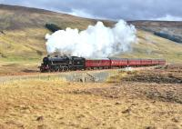 A break in the clouds allows the sun to shine on Black 5 No 45305 as it nears Luib Summit with the <I>Great Britain V</I> on 23 April. (The locomotive is missing the GB V headboard.)<br><br>[John Gray&nbsp;23/04/2012]