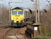 Freightliner 66561 on the approach to Troon with coal hoppers on 25 April 2012.<br><br>[John Steven&nbsp;25/04/2012]