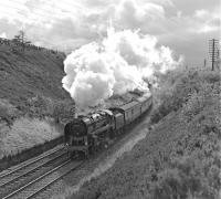 The exhaust from 92220 <I>Evening Star</I> is dramatically backlit as the 9F accelerates The 'Bishop Treacy special' away from Dent on 30 September 1978. This was one of two trains run on the same day at the end of that month in memory of the well known railway photographer, who had collapsed and died some four and a half months earlier while waiting to photograph No. 92220 at Appleby. <br><br>[Bill Jamieson 30/09/1978]