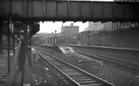 Looking back from the end of platform 6 (north) at Aberdeen during 'rationalisation' work in February 1973. View is across the truncated platform 7, with through platforms 8 and 9 beyond. Aberdeen North signal box is behind the camera. The building in the centre of the picture is the former suburban booking office and entrance to the covered cross-station walkway.<br><br>[John McIntyre&nbsp;/02/1973]