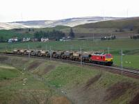 Northbound Carlisle Yard to Mossend Yard freight approaches Abington. (Plus lots of sheep with very cute lambs!)<br><br>[Beth Crawford&nbsp;30/04/2012]