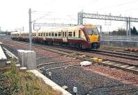 A Milngavie train about to run into platform 2 at Bathgate on 17 April 2012. The ScotRail stabling/cleaning roads can be seen in the background.<br><br>[John Furnevel&nbsp;17/04/2012]