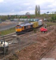 GBRf 66715 <I>Valour</I> passes construction works for Nuneaton's North Chord as it heads East with containers on Saturday lunchtime, 5 May 2012.<br><br>[Ken Strachan&nbsp;05/05/2012]
