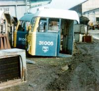 <I>'Somebody call me a cab...'</I>  Remains of 31005 (D5505) in the cutting-up area at Doncaster Works in February 1981. Part of sister locomotive 31003 (D5503) is in the background. Both are recorded as having been withdrawn from Stratford shed a year earlier. <br><br>[Colin Alexander&nbsp;/02/1981]