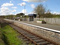 Cilmeri Station on the Heart of Wales line seen from a rarely used occupation crossing to the road on the left. The village is some half mile to the right <br><br>[David Pesterfield&nbsp;12/04/2012]