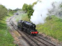 The repainted 'Turkish' Stanier 8F - seen here as LMS 8274 - running round at Winchcombe on 6 May 2012. [See image 37052] <br><br>[Peter Todd&nbsp;06/05/2012]