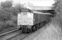 25033 passes through the site of Blackford Hill station with a westbound freight in November 1977.<br><br>[Bill Roberton&nbsp;/11/1977]