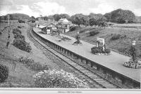 Old postcard showing the station at Alloway. View is to the east from just by the tunnel - probably from the footbridge (which collapsed in 1948 under the weight of the passengers on the Troon Old Parish Church Sunday School Trip). The station cottages can be seen on the right - their address is still Station Cottages. The high level goods yard is now the site of the new Burns Heritage Museum.<br><br>[Colin Miller Collection&nbsp;//]