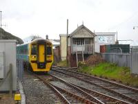158829 passes the disused Pwllheli Frame Box as it runs into Pwllheli Station 7 minutes early on the 13.10 arrival from Birmingham International on 9 May 2012. <br><br>[David Pesterfield&nbsp;09/05/2012]
