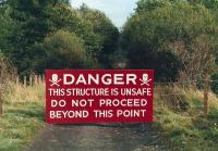 Warning sign on the approach to Byreburn Viaduct on the Langholm Branch in 1987. The wire presented no problems to the locals. Little trace now remains of the former structure. [See image 38778]<br><br>[Bruce McCartney&nbsp;//1987]