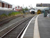158829 starts its 35 minute lay over at Pwllheli on 9 May before forming the 13.38 to Birmingham International. The overnight servicing siding is to the left <br><br>[David Pesterfield&nbsp;09/05/2012]