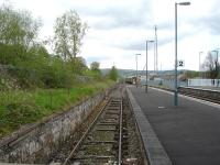 Tram type sleepers with tie bars seen on the still active line in the former west end bay at Newtown in May 2012. In the background the 12.04 departure to Aberystwyth & Pwllheli has just left the station.<br><br>[David Pesterfield&nbsp;08/05/2012]