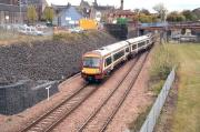 The 12.18 from Glasgow Queen Street takes the platform line at Alloa station junction on 9 May 2012.<br><br>[John Furnevel&nbsp;09/05/2012]