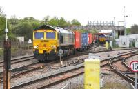 Freightliner 66540 gets the road east through Didcot on 17 May 2012 with a load of containers from Wentloog, Cardiff, heading for Southampton. <br> <br><br>[Peter Todd 17/05/2012]