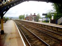 Less passengers than in the 2010 view from the same spot [see image 30654], but Arnside station still looks great in May 2012.<br><br>[Ken Strachan&nbsp;13/05/2012]