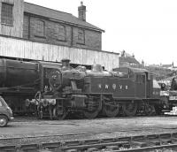 Ivatt 2MT tank No. 41241 in a version of LMS red with the Keighley and Worth Valley initials on its tank sides stands in Haworth Yard on Sunday 28 March 1976.<br><br>[Bill Jamieson&nbsp;28/03/1976]