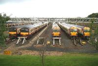 Trains stabled in the yard at Yoker Depot, Glasgow, on a wet and windswept Sunday morning in September 2007. View is west towards Dumbarton and Helensburgh, with the main line running past on the right of the picture.<br><br>[John Furnevel&nbsp;23/09/2007]