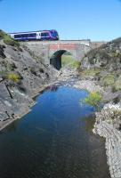 A northbound passenger train approaches Dalnacardoch from the south. In scorching heat that pool looked inviting.<br><br>[Ewan Crawford&nbsp;25/05/2012]