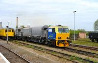 A Networrk Rail track cleaning unit standing in the sidings at Didcot on 17 May 2012. <br><br>[Peter Todd 17/05/2012]