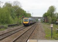 Gilberdyke station sees two Trans-Pennine 170 units heading west from Hull to Manchester Airport with a Sunday evening service. The semaphore signal indicates they are taking the Selby and Leeds route rather than the Goole and Doncaster line. <br><br>[Mark Bartlett&nbsp;20/05/2012]