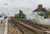 Eastrington, now an unstaffed halt on the Gilberdyke to Selby line, seen here in May 2012 with a view from the level crossing east towards Gilberdyke and Hull. <br><br>[Mark Bartlett&nbsp;20/05/2012]