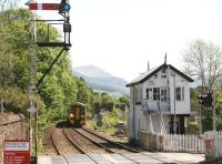 A 158 forming the 10.35 Edinburgh - Inverness comes off the Tilt Viaduct on an exceptionally hot 28 May and slows for the Blair Atholl stop. Platform view south over Ford Road level crossing.<br><br>[John Furnevel&nbsp;28/05/2012]