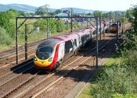 A northbound Pendolino hurries through Beattock on 27 May 2012 as a pair of DBS Class 66s are held in the loop waiting for a path north.<br><br>[John McIntyre&nbsp;27/05/2012]