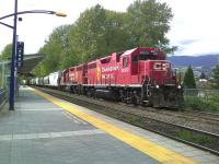 A freight train consisting of 120 empty grain hoppers passing through Coquitlam, British Columbia, on 8 May 2012.<br><br>[Malcolm Chattwood 08/05/2012]