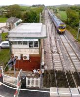 Looking North over the signal box at Hest Bank on what Winnie the Pooh would undoubtedly call a Blustery Day. A Transpennine 185 heads south towards the level crossing on 13 May 2012.<br><br>[Ken Strachan&nbsp;13/05/2012]