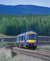 A southbound service heads round the curve south of Dalwhinnie station.<br><br>[Ewan Crawford&nbsp;22/05/2012]
