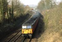 47717 heads east towards Salisbury with an Exeter to Waterloo service as it approaches Wilton Jct on 27 February 1992. The photo was taken on The Avenue road bridge over the railway and the ex GWR line to Westbury is through the trees immediately on the right.<br><br>[John McIntyre&nbsp;27/02/1992]