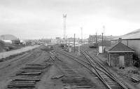 View west from Bathgate Central signalbox in December 1983, with tracklifting in progress. The former through station building is in the left background, beyond the new access road to what would become the car terminal.<br><br>[Bill Roberton&nbsp;08/12/1983]