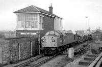 40135 draws its train of empty cartics past Bathgate Central signal box in December 1983. No track survived on the other side of the signalbox by this time. [See image 39045]<br><br>[Bill Roberton&nbsp;08/12/1983]