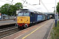 A pair of DRS Class 57s with 57002 leading, heading south through Leyland station on 23 May 2012 with the 6K73 Sellafield to Crewe freight.<br><br>[John McIntyre&nbsp;23/05/2012]