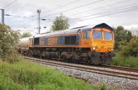 GB Railfreight 66733 leaves Millerhill Yard with the 6E45 Bridgeton Yard (ex-Fort William) Alcan empties to North Blyth on 4 June.<br><br>[Bill Roberton&nbsp;04/06/2012]