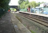 View along the disused but now tidied-up platform at Burscough Jct on 21 August 2010. The view is from slightly further north than the photograph 24 years earlier [see image 38989]. Class 142s are often still seen on the Preston - Ormskirk shuttle, however on the day in question I was much too involved in my work to photograph passing trains! [Editor's note: Alongside Burscough Junction station stands a well known local hostelry named 'The Junction Hotel.']<br><br>[John McIntyre 21/08/2010]