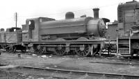 J52 0-6-0ST no 68824, thought to have been photographed awaiting its fate at Doncaster Works in May 1959. The locomotive had been withdrawn from Ardsley shed around 2 months earlier.<br><br>[K A Gray&nbsp;24/05/1959]