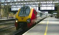 Virgin Voyager 221115 'William Baffin' arrives at Carlisle platform 3 on 26 May with train 1S47, the 12.00 Birmingham New Street to Glasgow Central.<br><br>[Ken Browne&nbsp;26/05/2012]