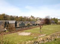 Shortly after leaving Keith Town station the line to Dufftown passes these former goods facilities. The board reads <I>J&B Scotch Whisky, Strathmill Distillery.</I> Photographed on 20 May 2012 looking back from a passing Keith - Dufftown train.<br><br>[John Furnevel&nbsp;20/05/2012]