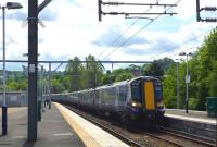 A 7-coach 380 from Glasgow gingerly squeezes into Platform 2 at the new Gourock station on 1st June 2012. <br><br>[Colin Miller&nbsp;01/06/2012]