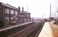 Electrification work underway at Shepreth to the south west of Cambridge in the 1980s. View is south west over Station Road level crossing looking towards Hitchin. Electrification of the Kings Cross - Cambridge line was completed in 1988. <br><br>[Ian Dinmore&nbsp;//]
