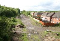 Site of the new station at Newtongrange looking south from the A7 road bridge on 9 June 2012. The headgear of Lady Victoria Colliery can just be seen poking above the trees on the left. [See image 13785]<br><br>[John Furnevel&nbsp;09/06/2012]